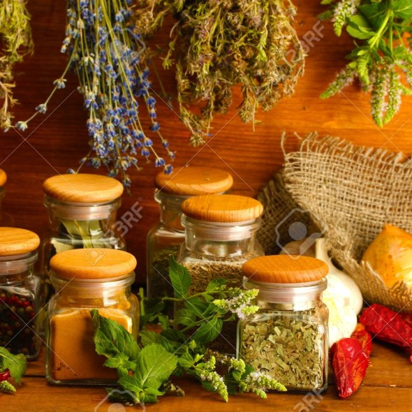 15048629-dried-herbs-spices-and-and-pepper-on-wooden-background